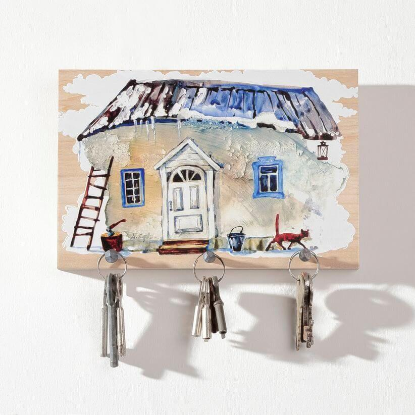 wooden key rack with a country home painting