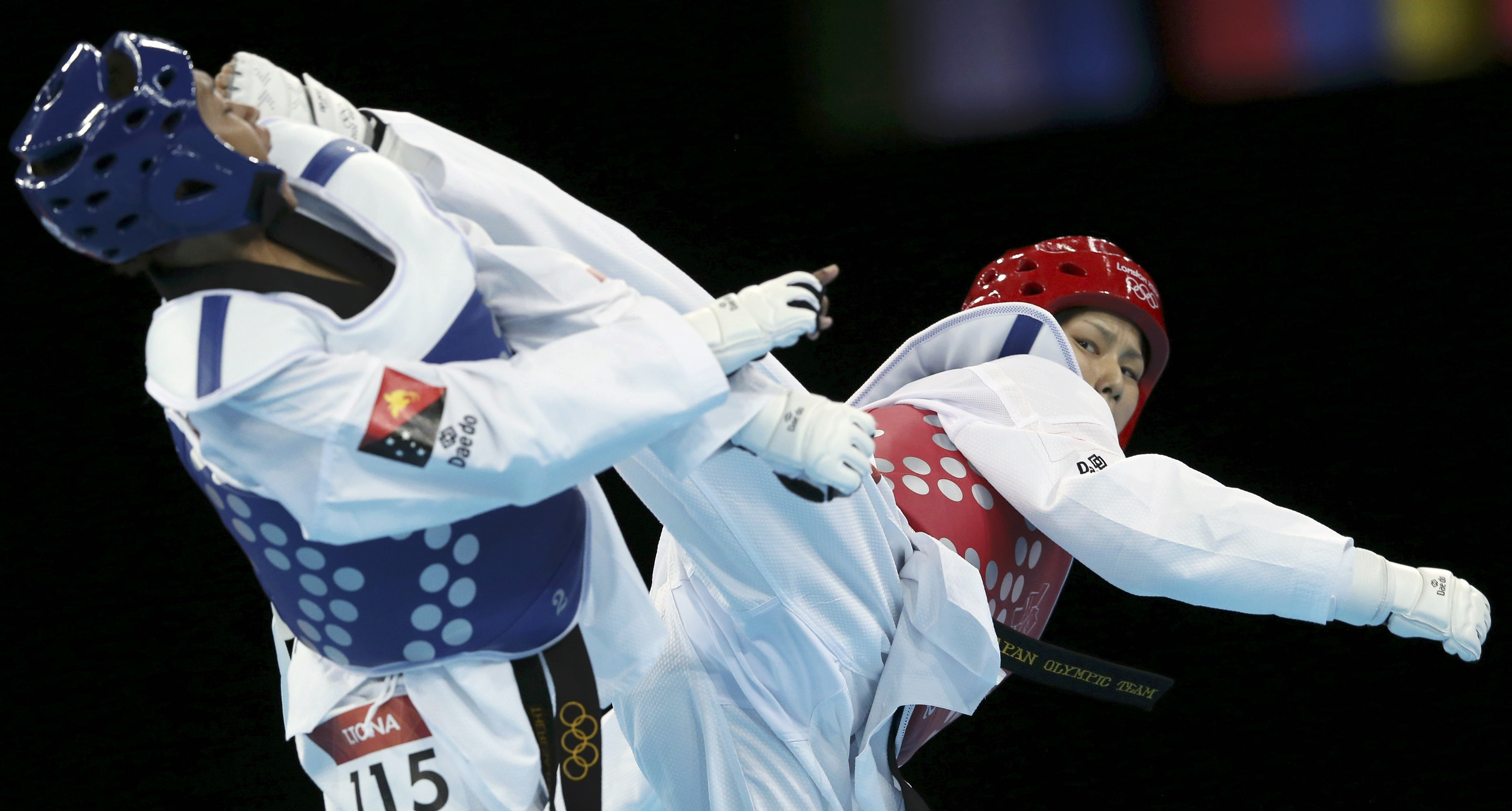 Japan's Erika Kasahara fights against Papua New Guinea's Theresa Tona during their women's -49kg preliminary round taekwondo match at the London Olympic Games
