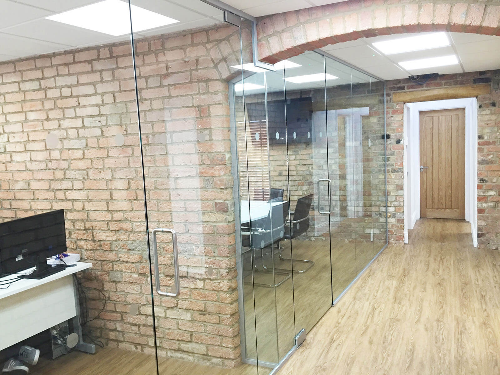 glass and brick Office Space with Partitions