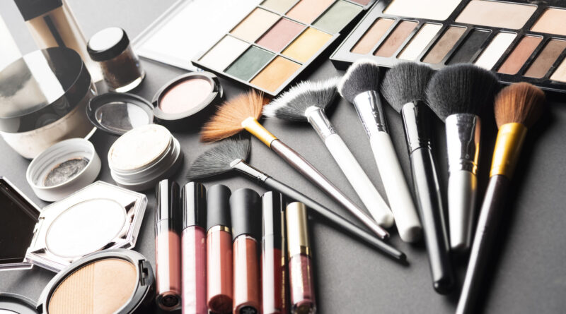 Multiple cosmetic products on black background.